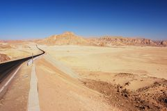 Sinai desert, Egypt. Empty road leading through the Sinai desert, Egypt Royalty Free Stock Images