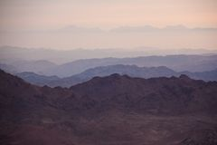 Sinai desert with sand and sun rise in december with mountains a. T monastery at Moses mountain stock photo