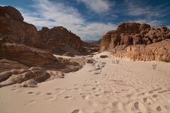 Sinai desert with sand and sun under blue sky in december. Sinai desert with sand and sun under blue sky stock image