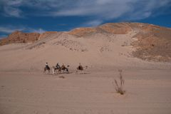 Sinai desert with sand and sun under blue sky in december with p. Eople on camels Stock Photo
