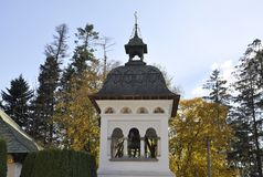 Sinaia Monastery Bell Tower nearby Peles Castle from Romania. Beautiful Sinaia Monastery Bell Tower nearby Peles Castle from Sinaia in Romania on 20th october stock photography