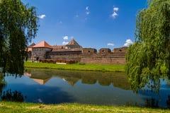Medieval castle Fagaras, Romania. Medieval castle and its water reflection, Fagaras, Romania Royalty Free Stock Image
