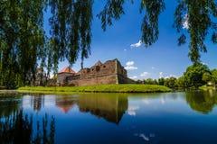 Medieval castle Fagaras, Romania. Medieval castle and its water reflection, Fagaras, Romania Royalty Free Stock Photos