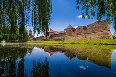 Medieval castle Fagaras, Romania. Medieval castle and its water reflection, Fagaras, Romania stock photography