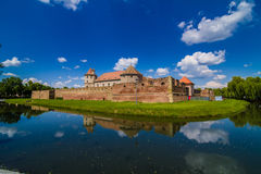 Medieval castle Fagaras, Romania. Medieval castle and its water reflection, Fagaras, Romania stock photos