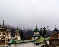 Sinaia orthodox church outside the monastery walls. Dramatic clouds seen above. Sinaia orthodox church oute the monastery walls. Dramatic clouds seen above stock images