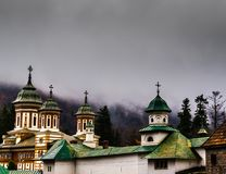 Sinaia orthodox church outside the monastery walls. Dramatic clo. Uds seen above Stock Photos