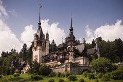Sinaia, Peles Castle on a green hill in beautiful Landscape stock photography