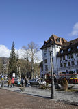 Sinaia RO, december 27th: Downtown plaza and Cerbul Hotel from Sinaia resort in Romania Royalty Free Stock Photo
