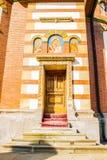 Sinaia, Romania - March 09, 2019: back entrance, wood door,  Sinaia Monastery located in Sinaia, Prahova, Romania. Sinaia, Romania - March 09, 2019: back stock images