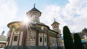 Sinaia, Romania - March 09, 2019: View of Sinaia Monastery with real sun lens flare located in Sinaia, Prahova county, Romania.  stock image