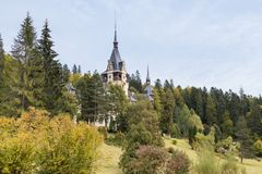 Peles castle and its garden in Sinaia, in Romania Royalty Free Stock Images