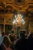 Tourists inspect the interior of the Peles castle in Sinaia, in Romania Stock Photo