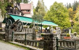 Two guns at the entrance to the bar Regal located near Pelesh castle in Sinaia, in Romania Stock Photos