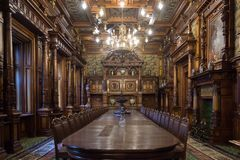 Sinaia / Romania / September 23, 2017: Dining room in the castle Peles in Sinaia in Romania. royalty free stock photo