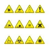 Sinais amarelos do aviso e do perigo Foto de Stock Royalty Free