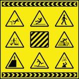 Sinais de aviso 4 do perigo Fotografia de Stock