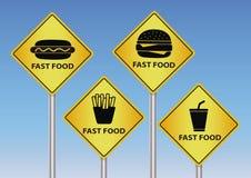 Sinais de estrada do fast food foto de stock