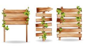 Sinais de madeira do vetor com folhas verdes ilustração do vetor