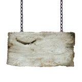 Sinais de madeira velhos que penduram em uma corrente Imagens de Stock Royalty Free