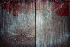 Sinais do coração no fundo de madeira Fotografia de Stock Royalty Free