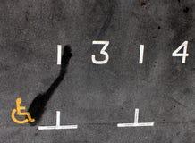 Sinais do estacionamento & mancha de petróleo Imagem de Stock Royalty Free