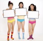 Sinais e meninas coloridas imagens de stock