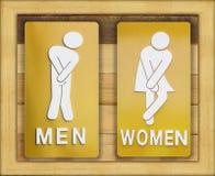 Sinais fêmeas e banheiro masculino no fundo de madeira Imagens de Stock Royalty Free
