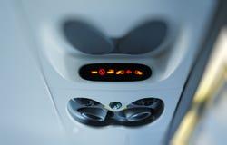 Sinais iluminados no avião Imagem de Stock Royalty Free