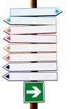Sinais multicoloridos da seta direcional da estrada transversaa Foto de Stock