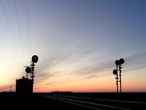 Sinais Railway mostrados em silhueta no por do sol Fotografia de Stock