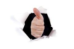 Sinal aprovado da mão através do furo da parede Fotos de Stock