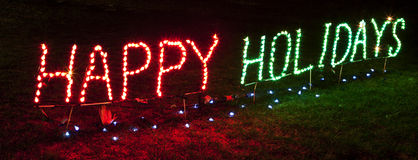 Sinal boas festas brilhantemente iluminado Foto de Stock Royalty Free