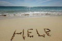 Sinal da ajuda na praia imagens de stock royalty free