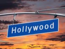 Sinal da avenida de Hollywood com por do sol Imagens de Stock