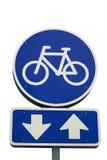 Sinal da bicicleta com setas Fotografia de Stock Royalty Free