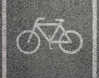 Sinal da bicicleta no asfalto Imagens de Stock