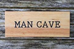 Sinal da caverna do homem Fotografia de Stock Royalty Free