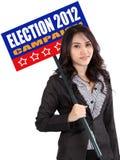 Sinal da eleição da terra arrendada da mulher Imagens de Stock