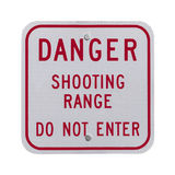 Sinal da escala de tiro do perigo Foto de Stock