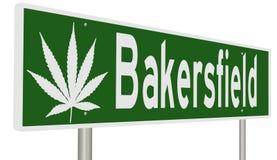 Sinal da estrada para Bakersfield Califórnia com folha da marijuana Fotografia de Stock