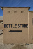 Sinal da loja da garrafa Foto de Stock Royalty Free