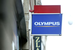 Sinal da loja de Olympus Fotos de Stock Royalty Free