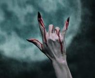 Sinal da mão da rocha de Dia das Bruxas Foto de Stock