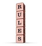 Sinal da palavra das regras Pilha vertical de Rose Gold Metallic Toy Blocks Imagens de Stock Royalty Free