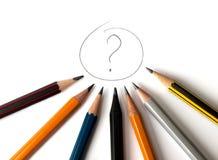 Sinal da pergunta com os lápis em torno dele Imagem de Stock Royalty Free