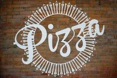 Sinal da pizza na parede Imagem de Stock Royalty Free