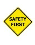Sinal da segurança em primeiro lugar em um branco Fotos de Stock Royalty Free