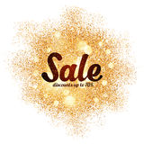 Sinal da venda no respingo dourado do brilho no branco Foto de Stock