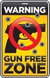 Sinal da zona franca de arma com buracos de bala Fotos de Stock Royalty Free